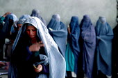 Afghan woman at a support centre for women who have been widowed by the Afghan civil war. The centre offers them food rations on a monthly basis. Kabul , Afghanistan 2002 - Thomas Morley - &,2000s,2002,afghan,afghanistan,afghans,apparel,asia,belief,burka,burkas,burqa,burqas,charitable,charity,Civil War,clothes,clothing,conflict,conflicts,conviction,developing,dress,EQUALITY,excluded,exc