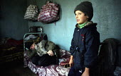 Chechen refugee families living in a camp formerly a Soviet military camp in Georgia. The refugees from Grozny and nearby villages had walked to Georgia. Duisi, Pankisi Gorge, Georgia 2003 - Thomas Morley - 05-02-2003