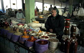 An Abkhazian woman sells herbs and spices in the Abkhaz market, Tbilisi Georgia. The market is run by the Abkhazian Georgian refugees and has at times been a place of tension between them and indigeno... - Thomas Morley - 05-03-2003