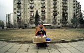 An Abkhazian refugee sells old household items amongst the dilapidated tower blocks sit upon the high ground over looking Georgias capital Tbilisi have been home for many of the 350,000 Abkhazian refu... - Thomas Morley - 05-03-2003