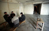 Young Abkhazian men playing cards in Tbilisis old Industrial college dormitory block. It was cleared out in 1994 to accommodate the rising number of refugees from Abkhazia. More than 350,000 refugees... - Thomas Morley - 05-03-2003