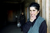An Abkhazian Georgian refugee stands in the door way of an old condemned ex-soviet factory building in Zugdidi, where some of the towns 120,000 strong refugee population live. More than 350,000 refuge... - Thomas Morley - 05-03-2003