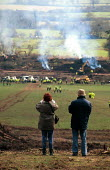 Locals watching removal of protesters against the Newbury bypass 1997 - Howard Davies - 1990s,1997,activist,activists,against,anti,bailiff,bailiffs,building site,burn,burning,BURNS,bypass,CAMPAIGN,campaigner,campaigners,CAMPAIGNING,CAMPAIGNS,construction industry,DEMONSTRATING,Demonstrat