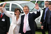 Cherie and Tony Blair arriving at Labour Party general election campaign meeting, Watford, a marginal seat - Val Reynolds - 2000s,2005,ARRIVAL,arrivals,arrive,arrived,arrives,arriving,campaign,campaigning,CAMPAIGNS,Cherie Blair,DEMOCRACY,election,elections,general,Labour Party,meeting,MEETINGS,mp,MPs,Party,pol,political,po