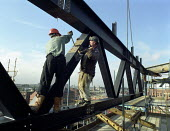 Construction workers bolting steel girders high above Manchester. - Len Grant - 20-02-2002