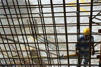 Construction worker with steel concrete reinforcements. - Len Grant - 20-02-2002