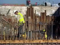 Worker on building site, Manchester. - Len Grant - 20-07-2002