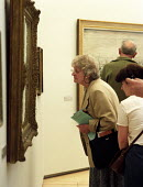 Looking at paintings at The Lowry, Salford Quays, Manchester. - Len Grant - 20-05-2002