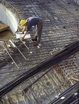 Looking at plans amongst steel reinforcements. Manchester. - Len Grant - 20-11-1997