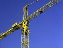 Yellow crane against blue sky on a construction site - Len Grant - 03-09-2001