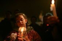 Stop the War on Iraq Candlelight Vigil, Trafalgar Square - Paul Mattsson - 2000s,2003,activist,activists,adolescence,adolescent,adolescents,anti war,Antiwar,BAME,BAMEs,Black,BME,bmes,CAMPAIGN,campaigner,campaigners,CAMPAIGNING,CAMPAIGNS,Candle,Candlelit,Candles,child,CHILDHO
