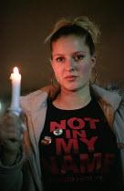 Stop the War on Iraq Candlelight Vigil, Trafalgar Square - Paul Mattsson - 2000s,2003,activist,activists,anti war,Antiwar,CAMPAIGN,campaigner,campaigners,CAMPAIGNING,CAMPAIGNS,Candle,Candlelit,Candles,DEMONSTRATING,demonstration,DEMONSTRATIONS,FEMALE,Iraq,Night,pacifism,Peac