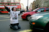 London Based Supporters of the PKK Leader Abdullah Ocalan stage a Sit Down Protest in Oxford Circus, Central London which succeded in Holding up and Stopping Rush Hour Traffic while bemused, passers b... - Paul Mattsson - 2000s,2003,activist,activists,Banned,CAMPAIGN,campaigner,campaigners,CAMPAIGNING,CAMPAIGNS,Death,DEATHS,DEMONSTRATING,DEMONSTRATION,DEMONSTRATIONS,died,highway,ISLAM,ISLAMIC,Kurdish,Kurdistan,Kurds,Le