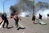 Anti Capitalist protesters making a burning barricade riot police and tear gas, Genoa G8 summit. - Paul Mattsson - 21-07-2001