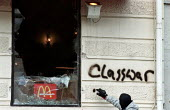 Protest against European Union summit meeting, Gothenburg Sweden. Protester spraying class war graffiti on a trashed McDonalds restaurant - Paul Mattsson - 15-06-2001