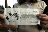 A journalist holds an invitation to a dinner party at British National Party leader Nick Griffin's home, near Welshpool, North Wales. The BNP leader was holding this event where the French National Fr... - Paul Mattsson - 2000s,2004,activist,activists,adult,adults,Anti Racism,anti racist,BNP,British National Party,Campaign,campaigner,Campaigners,CAMPAIGNING,CAMPAIGNS,DEMONSTRATING,DEMONSTRATION,DEMONSTRATIONS,Demonstra