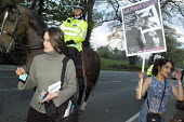 Female journalist shows her NUJ press card to try to cross police lines to reach British National Party leader Nick Griffin's home, near Welshpool, North Wales. The BNP leader was having a dinner part... - Paul Mattsson - 2000s,2004,activist,activists,adult,adults,Anti Racism,anti racist,BNP,British National Party,Campaign,campaigner,Campaigners,CAMPAIGNING,CAMPAIGNS,CLJ,DEMONSTRATING,DEMONSTRATION,DEMONSTRATIONS,dinne