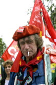 French trade union members march through Paris against the governments proposed pension reforms and public sector restructuring and privatisation plans - Paul Mattsson - 2000s,2003,activist,activists,against,Beret,CAMPAIGN,campaigner,campaigners,CAMPAIGNING,CAMPAIGNS,CGT,Cigarette,CIGARETTES,Cuts,DEMONSTRATING,demonstration,DEMONSTRATIONS,Dispute,Disputes,eu,Europe,eu