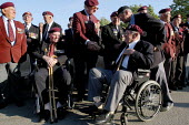 British and Canadian airborne veterans at local small town D Day sixtieth anniversary commemoration ceremony, Trouarn, Normandy, France - Paul Mattsson - 2000s,2004,2nd,adult,adults,age,ageing population,anniversary,army,Battle,Battles,Beret,Berets,bound,Britain,Canada,ceremonies,ceremony,citizens,COMMEMORATE,COMMEMORATING,commemoration,commemorations,