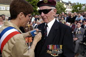 British airborne war veteran receives commemoration medal from the mayor at local small town D Day sixtieth anniversary commemoration ceremony, Trouarn, Normandy, France - Paul Mattsson - 06-06-2004