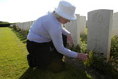 Barbara Nicholls from UK visits and pays her respects at her grandfather Private H. Nicholls of the Norfolk Regiment grave at the British and Commonwealth first world war cemetery at Mont Huon, Somme... - Paul Mattsson - 07-06-2004