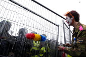 Protester confronts riot police protecting security fence G8 summit. G8 Alternatives march through Auchterarder, Perthshire. - Paul Mattsson - 2000s,2005,activist,activists,adult,adults,against,Anti,anti capitalism,Anti Capitalist,CAMPAIGN,campaigner,campaigners,CAMPAIGNING,CAMPAIGNS,CAPITALISM,capitalist,clj,Clown,Clowns,confront,confrontat