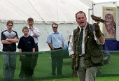 Border Union agricultural show, Kelso, Scottish Borders. Watching a falconry display - Paul Mattsson - 2000s,2002,animal,animals,Barbour Jacket,bird,bird of pray,Birds,birds of pray,Border,borders,Country,display,displays,ENI environmental issues,Falcon,Falconry,ground,hawk,hawks,Kelso,kestrel,LFL life