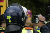Police cameraman. Protest against the BNP Red White and Blue festival, Codnor Derbyshire - Paul Mattsson - 2000s,2008,activist,activists,adult,adults,against,Anti Fascist,Anti Racism,anti racist,BNP,British National Party,camera,cameras,CAMPAIGN,campaigner,campaigners,CAMPAIGNING,CAMPAIGNS,CLJ,DEMONSTRATIN