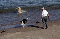Man and his dogs. Spittal beach, Berwick-upon-Tweed, Northumberland - Paul Mattsson - 31-08-2002