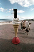 Pensioners day out. Spittal promenade, Spittal promenade, Berwick-upon-Tweed, Northumberland - Paul Mattsson - 2000s,2002,99,adult,adults,age,ageing population,Beach,BEACHES,Berwick-upon-Tweed,CLOUD,Clouds,COAST,coastal,coasts,cone,DAD,DADDIES,DADDY,DADS,elderly,families,FAMILY,Father,FATHERHOOD,FATHERS,flake,