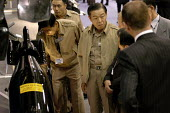 South Korean military officers showing some interest in a torpedo. Defence Systems and Equipment International Exhibition, Excel, Docklands - Paul Mattsson - 09-09-2003