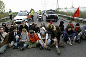 Anti arms trade protesters stage a spontaneous sit down and block one of the roads leading to the Defence Systems and Equipment International Exhibition at Excel, Docklands - Paul Mattsson - 10-09-2003