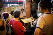 Men gambling and playing cards in the street. Shanghai, China. - Connor Matheson - 03-09-2015