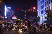 Busy city, tourists crossing Nanjing Road, Shanghai, China. - Connor Matheson - 05-09-2015