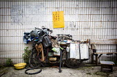 Old motorcycle buried beneath clothes shoes, inner tubes and lots of keys Kunming, Yunnan Province, China. - Connor Matheson - 10-09-2015