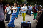 Square dancers, dancing in Cuihu Park, Kunming, Yunnan Province, China. - Connor Matheson - Chinese,2010s,2015,ACE,china,cities,City,Culture,dance,dancer,dancers,dancing,FEMALE,Green Lake Park,hobbies,hobby,hobbyist,Leisure,LFL,LIFE,male,man,melody,men,music,MUSICAL,outdoors,Park,parks,PEOPL