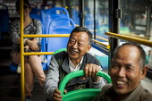 A Elderly man travels on the bus. Kunming, Yunnan Province, China. - Connor Matheson - 2010s,2015,age,ageing population,bus,bus service,buses,china,Chinese,EBF,Economic,Economy,elderly,EMOTION,EMOTIONAL,EMOTIONS,funny,happiness,happy,Humor,HUMOROUS,HUMOUR,joking,journey,JOURNEYS,laugh,l