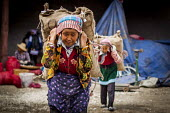 Elderly Bai women carrying sacks at the local market, Dali, Yunnan Province, China. - Connor Matheson - 18-09-2015