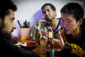 A Chinese local arguing with some Israeli tourists after a night of drinking. Dali, China. - Connor Matheson - 2010s,2015,alcohol,argue,arguing,argument,at,bar,bars,beer,binge,china,Chinese,cities,City,communicating,communication,conversation,conversations,dialogue,discourse,discuss,discusses,discussing,discus