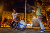 Children playing on the street late at night. Dongcheng, Yunnan Province, China. - Connor Matheson - Chinese,2010s,2015,boy,boys,child,CHILDHOOD,children,china,cities,City,female,females,game,games,girl,girls,Housing,juvenile,juveniles,kid,kids,Leisure,LFL,LIFE,male,people,play,playing,RECREATION,REC