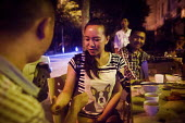 Chinese drinkers playing finger guessing drinking game at a bar. Dongcheng, Yunnan Province, China. - Connor Matheson - 28-09-2015