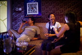 Young people singing in KTV karaoke. Dongchuan, Yunnan Province, China. - Connor Matheson - 29-09-2015