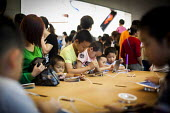 Wealthy Chinese children looking at Ipads inside the Apple Store, Nanjing Road, Shanghai, China. - Connor Matheson - 04-10-2015