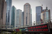 Shanghai Stock Exchange prices displayed on a bridge, Lujiazui Financial District, Pudong, Shanghai, China. - Connor Matheson - 05-10-2015