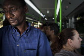 Malta, Mahjoub a Sudanese refugee traveling to Valletta to obtain his police record which is needed to obtain a new Work Permit, Valletta, Malta. - Connor Matheson - 20-07-2015