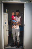 Somali refugee and his child, Hal Far Refugee Camp, Malta. - Connor Matheson - 10-08-2015