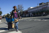 Homeless on the Street, Berkeley, California - David Bacon - 2010s,2015,African American,African Americans,America,American,americans,bag,bags,BAME,BAMEs,black,BME,bmes,California,cart,carts,cities,City,diversity,EQUALITY,ethnic,ethnicity,excluded,exclusion,FEM