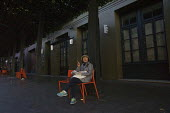 Homeless on the Street, Berkeley, California - David Bacon - American,2010s,2015,America,American,americans,asian,asians,at,BAME,BAMEs,BME,bmes,California,chair,chairs,chinese,cigarette,cigarettes,cities,City,dark,Diaspora,diversity,EQUALITY,ethnic,ethnicity,ex