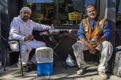 Construction workers lunch break, coffee house, Berkeley, California - David Bacon - 04-11-2015