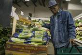 California, shopping in a grocery store, Berkeley - David Bacon - , American,2010s,2015,African American,African Americans,America,American,americans,BAME,BAMEs,basket,black,BME,bmes,bought,buy,buyer,buyers,buying,California,celery,choice,choosing,cities,City,commod